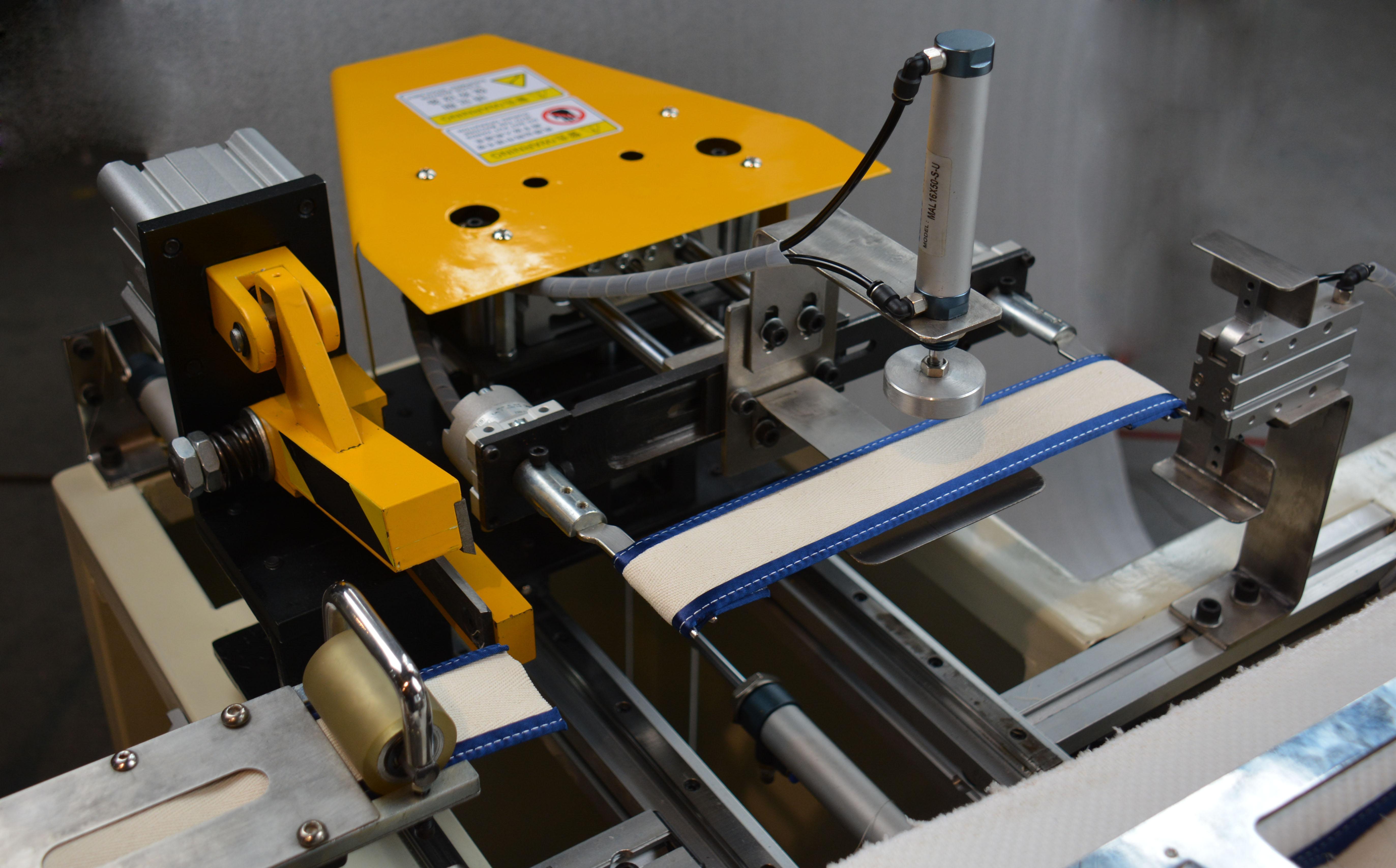 全自动拉手带缝纫机